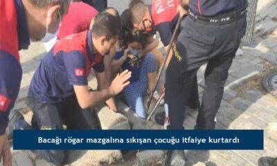 Bacağı rögar mazgalına sıkışan çocuğu itfaiye kurtardı