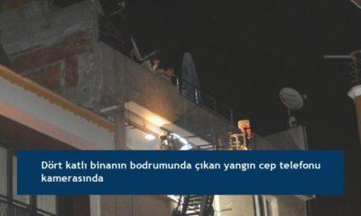 Dört katlı binanın bodrumunda çıkan yangın cep telefonu kamerasında
