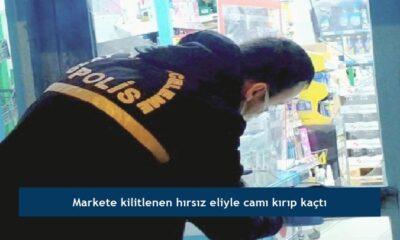 Markete kilitlenen hırsız eliyle camı kırıp kaçtı